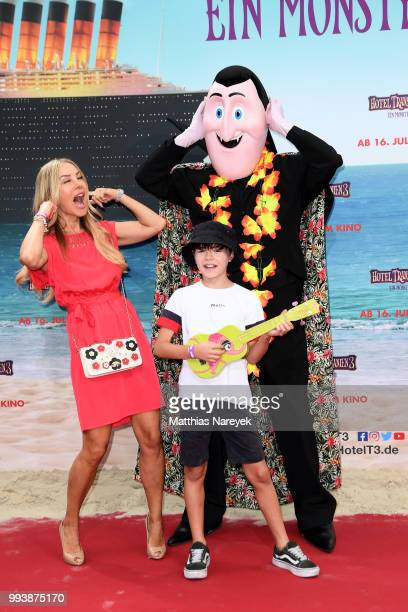 Xenia Seeberg and her son PhilippElias Martinek attend the 'Hotel Transsilvanien 3' premiere at CineStar on July 8 2018 in Berlin Germany