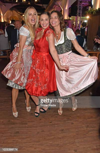 Xenia Seeberg Daniela Dany Michalski and Gitta Saxx during the Angermaier TrachtenNacht at Hofbraeuhaus on August 30 2018 in Berlin Germany