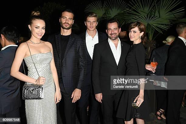 Xenia Tchoumi Giulio Berruti Toby Huntington Whiteley Stephane Gerschel and Nathalie Rapti Gomez attend BVLGARI Dinner Party during Milan Fashion...