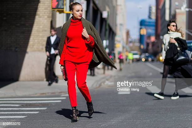 Xenia Tchoumitcheva is wearing red sweater and pants by Pinko seen outside Rebecca Minkoff during New York Fashion Week Women's Fall/Winter 2016 on...