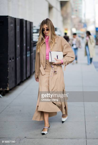 Xenia van der Woodsen wearing beige coat skirt seen outside Michael Kors on February 14 2018 in New York City