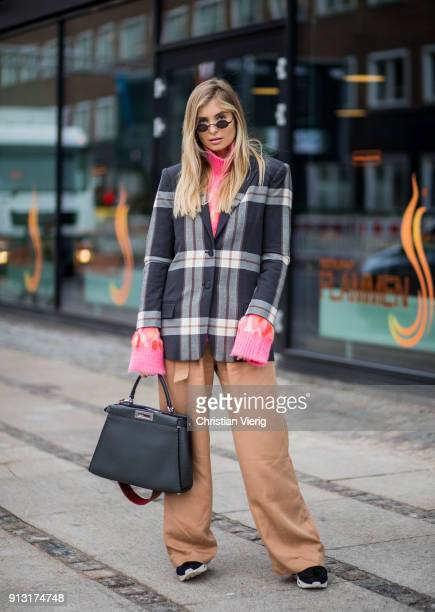 Xenia van der Woodsen wearing brown wide leg pants Fendi bag checked blazer pink turtleneck during the Copenhagen Fashion Week Autumn/Winter 18 on...