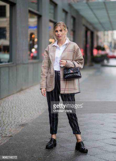 Xenia van der Woodsen wearing checked jacket striped pants Chanel bag is seen outside Lana Mueller during the Berlin Fashion Week January 2018 on...