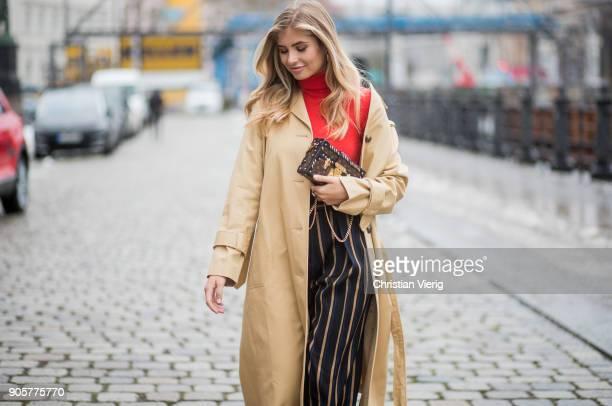 Xenia van der Woodsen wearing Louis Vuitton shoes striped By Malene Birger pants trench coat Topshop Marc Cain top Celine earrings Louis Vuitton...