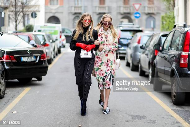 Xenia van der Woodsen wearing red leather gloves silver bag and Leonie Sophie Hanne wearing floral print jacket and skirt is seen outside Dolce...