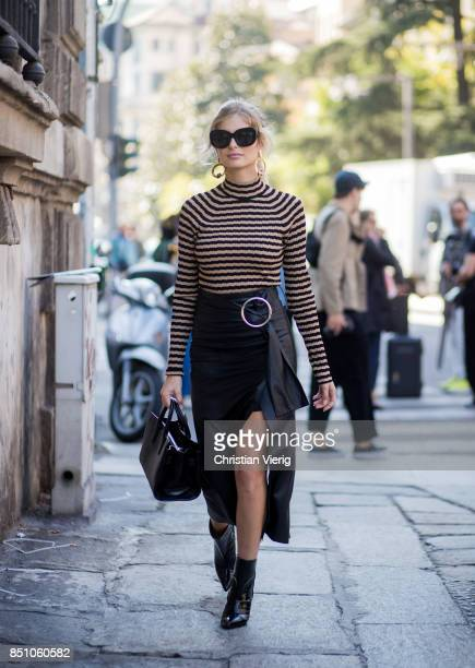 Xenia van der Woodsen wearing stripped top black skirt is seen outside Max Mara during Milan Fashion Week Spring/Summer 2018 on September 21 2017 in...