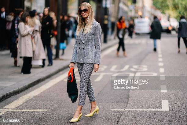 Xenia Van Der Woodsen 'Xenia Overdose' wears a gray blazer jacket cropped checkered pants yellow shoes a green bag sunglasses outside Topshop during...