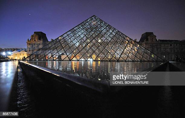 Xenon for Paris a work by US conceptual artist Jenny Holzer is projected on the Louvre museum's pyramid as well as the Louvre�s facade on April 9...