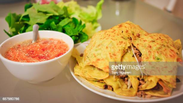 Xeo cake (banh xeo) with vegetables and fish sauce, vietnamese crepe, vietnamese crispy pancake, vietnamese cuisine