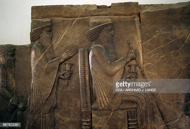 Xerxes and King Darius I on his throne ca 515 BC relief from the Treasury of Persepolis Iran Teheran MuzeIe IranE Bastan