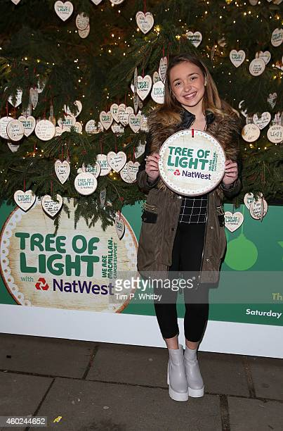 Factor contestant Lauren Platt poses for a photo during the official opening of the Macmillan Tree of Light with NatWest at the Southbank Centre on...