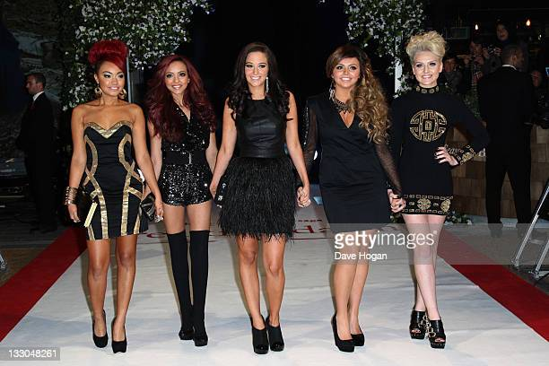 Factor judge Tulisa Contostavlos and Perrie Edwards, Leigh-Anne Pinnock, Jade Thirwall and Jesy Nelson from X Factor group Little Mix attend the UK...