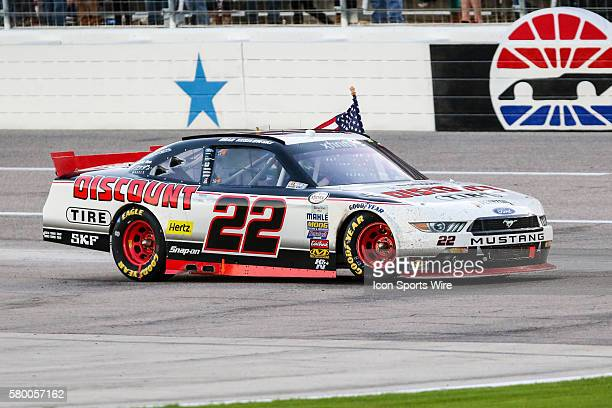 Xfinity Series driver Brad Keselowski does a burnout after winning the NASCAR Xfinity Series O'Reilly's Auto Parts Challenge at the Texas Motor...