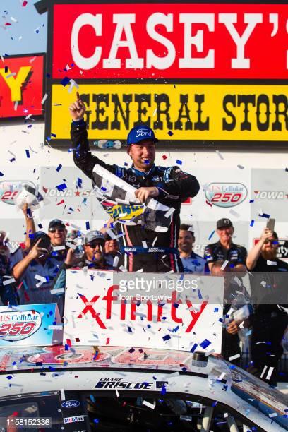 Xfinity Series driver Chase Briscoe celebrates winning the NASCAR Xfinity Series US Cellular 250 on July 27 at Iowa Speedway in Newton, Iowa.