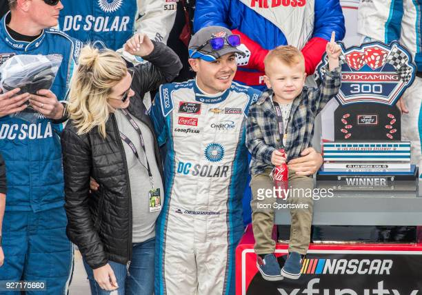Xfinity Series driver Kyle Larson poses with his wife and son during the awards celebration at the Boyd Gaming 300 NASCAR Xfinity Series on March 3...