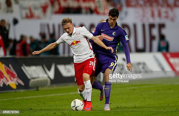 xGeorg Teigl of Leipzig is challenged by Tim Kleindienst of Freiburg during the Second Bundesliga match between RB Leipzig and SC Freiburg at Red...