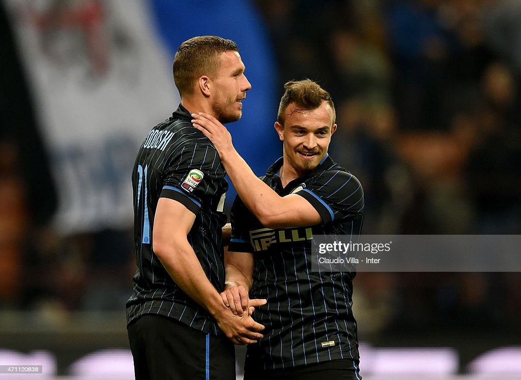 Xherdan Shaqiri (R) and Lukas Podolski of FC Internazionale celebrate at the end of the Serie A match between FC Internazionale Milano and AS Roma at Stadio Giuseppe Meazza on April 25, 2015 in Milan, Italy.