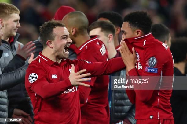 Xherdan Shaqiri and Trent AlexanderArnold of Liverpool celebrate after the UEFA Champions League Semi Final second leg match between Liverpool and...