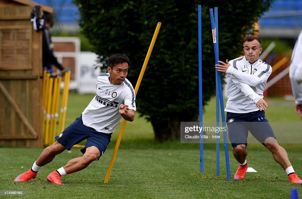 Xherdan Shaqiri (R) and Yuto Nagatomo in action during FC Internazionale training session at the club's training ground at Appiano Gentile on May 22, 2015 in Como, Italy.
