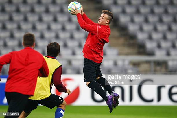 Xherdan Shaqiri catches the ball during a FC Basel training session ahead of their UEFA Champions League Round of 16 second leg match against FC...
