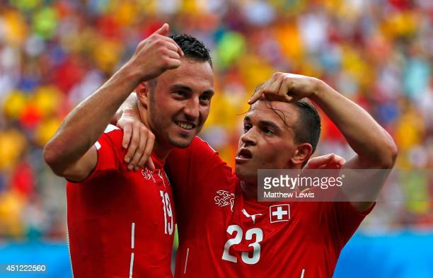 Xherdan Shaqiri celebrates scoring his team's second goal with Josip Drmic of Switzerland during the 2014 FIFA World Cup Brazil Group E match between...