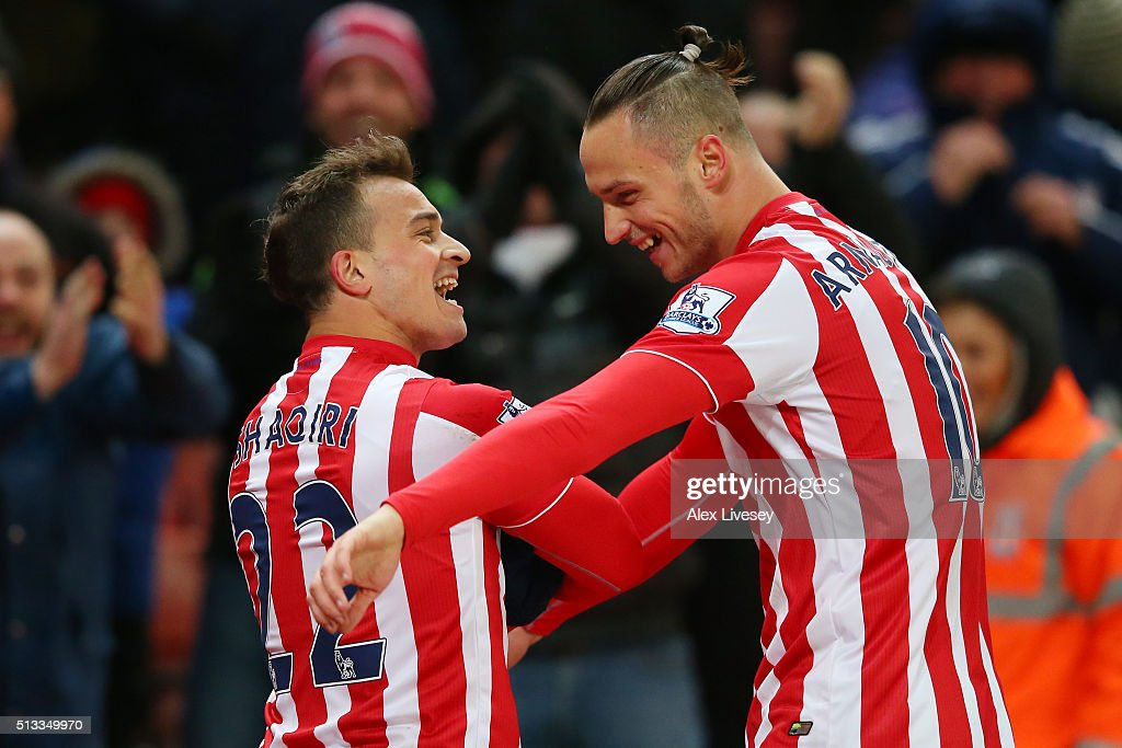 Xherdan Shaqiri celebrates with Marko Arnautovic after scoring the opening goal during the Barclays Premier League match between Stoke City and Newcastle United at the Britannia Stadium on March 2, 2016 in Stoke on Trent, England.