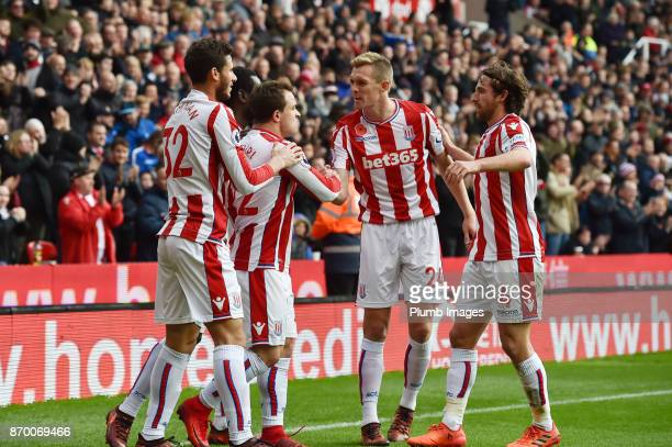 Xherdan Shaqiri celebrates with team mates after scoring to make it 11 during the Premier League match between Stoke City and Leicester City at The...