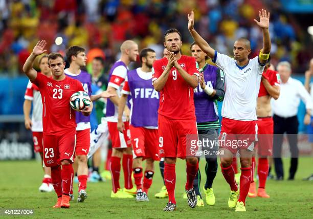 Xherdan Shaqiri Haris Seferovic and Gokhan Inler of Switzerland acknowledge the fans after a 30 victory over Honduras in the 2014 FIFA World Cup...