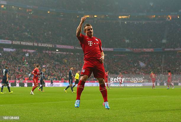 Xherdan Shaqiri of Bayern Muenchen celebrates scoring the opening goal during the Bundesliga match between FC Bayern Muenchen and Hamburger SV at...