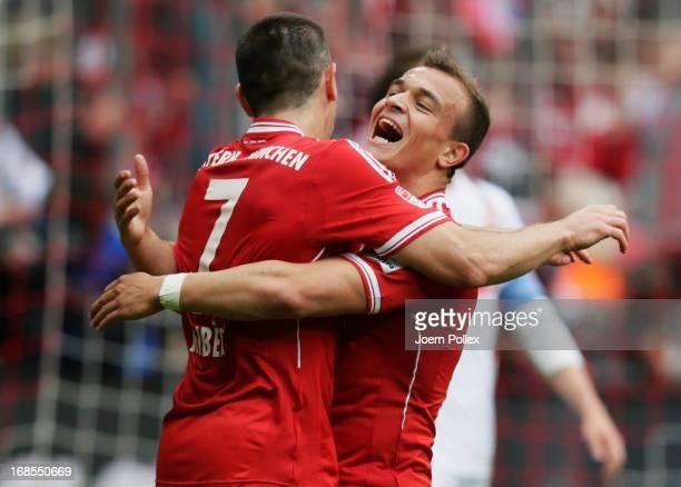 Xherdan Shaqiri of Bayern Muenchen celebrates with Franck Ribery as he scores their second goal during the Bundesliga match between FC Bayern...