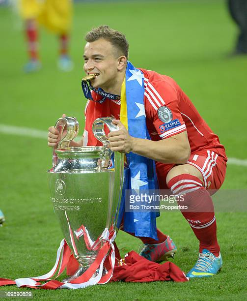 Xherdan Shaqiri of Bayern Muenchen celebrates with the trophy after the UEFA Champions League final match between Borussia Dortmund and FC Bayern...