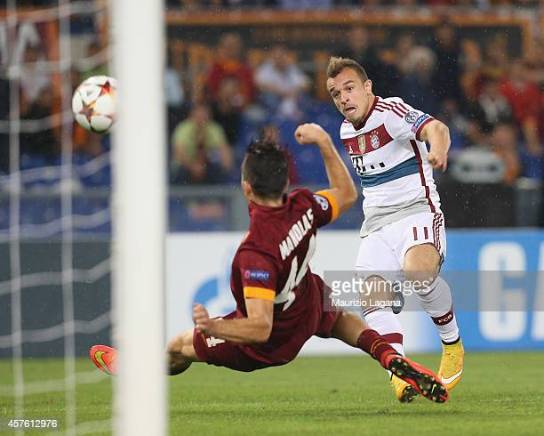 Xherdan Shaqiri of Bayern Muenchen scores his team's goal during the UEFA Champions League match between AS Roma and FC Bayern Munchen at Stadio...