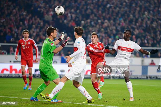 Xherdan Shaqiri of FC Bayern Muenchen misses a chance at goal under the pressure of Antonio Ruediger of VfB Stuttgart during the Bundesliga match...
