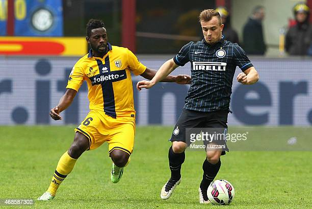 Xherdan Shaqiri of FC Internazionale Milano competes for the ball with Silvestre Varela of Parma FC during the Serie A match between FC...