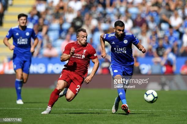 Xherdan Shaqiri of Liverpool and Rachid Ghezzal of Leicester City battle for the ball during the Premier League match between Leicester City and...