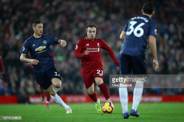 Xherdan Shaqiri of Liverpool battles for possession with Nemanja Matic of Manchester United during the Premier League match between Liverpool FC and...