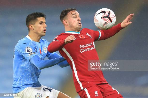 Xherdan Shaqiri of Liverpool battles with Joao Cancelo of Man City during the Premier League match between Manchester City and Liverpool at Etihad...