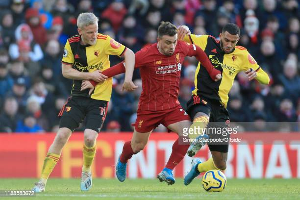 Xherdan Shaqiri of Liverpool battles with Will Hughes of Watford and Etienne Capoue of Watford during the Premier League match between Liverpool FC...