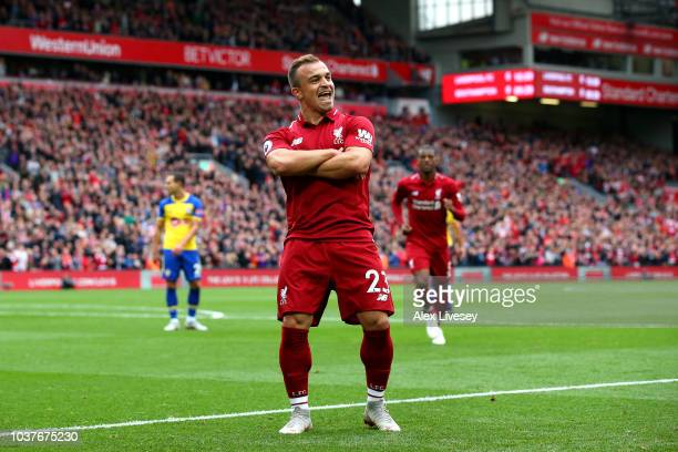 Xherdan Shaqiri of Liverpool celebrates after he provides the assist for Liverpool's first goal, an own goal by Wesley Hoedt of Southampton during...