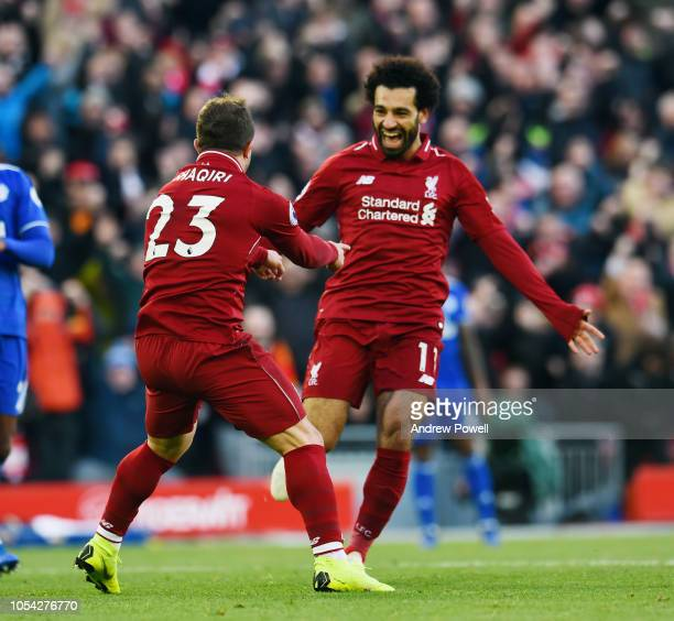 Xherdan Shaqiri of Liverpool celebrates after scoring a goal during the Premier League match between Liverpool FC and Cardiff City at Anfield on...