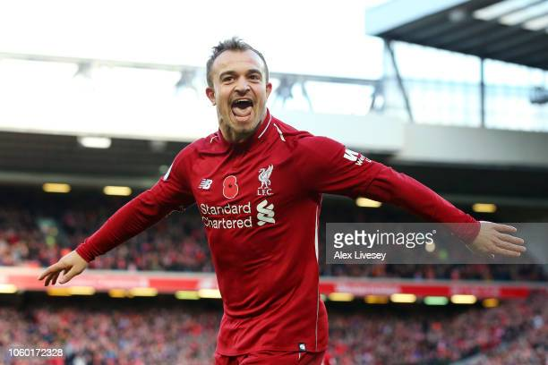 Xherdan Shaqiri of Liverpool celebrates after scoring his team's second goal during the Premier League match between Liverpool FC and Fulham FC at...