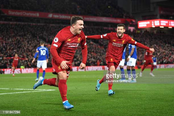 Xherdan Shaqiri of Liverpool celebrates after scoring his team's second goal during the Premier League match between Liverpool FC and Everton FC at...