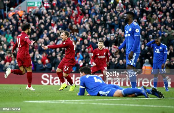 Xherdan Shaqiri of Liverpool celebrates after scoring his team's third goal during the Premier League match between Liverpool FC and Cardiff City at...