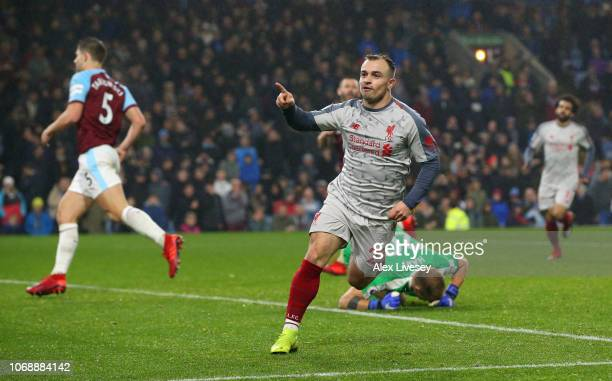 Xherdan Shaqiri of Liverpool celebrates after scoring his team's third goal during the Premier League match between Burnley FC and Liverpool FC at...