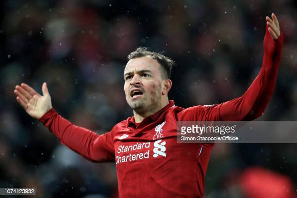 Xherdan Shaqiri of Liverpool celebrates after scoring their 2nd goal during the Premier League match between Liverpool and Manchester United at...