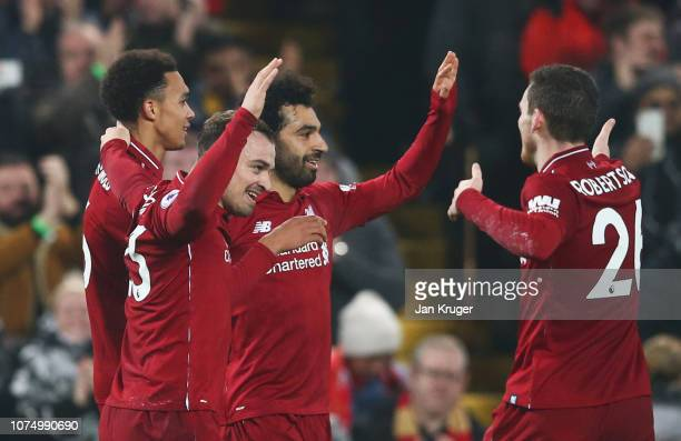 Xherdan Shaqiri of Liverpool celebrates as he scores his team's third goal with team mates during the Premier League match between Liverpool FC and...