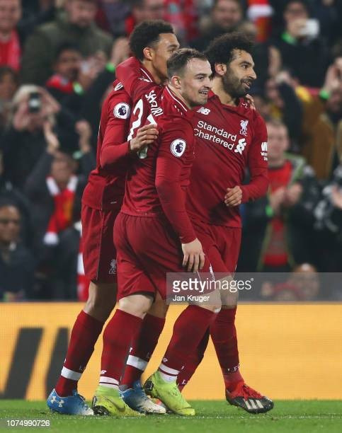 Xherdan Shaqiri of Liverpool celebrates as he scores his team's third goal with team mates Trent AlexanderArnold and Mohamed Salah during the Premier...