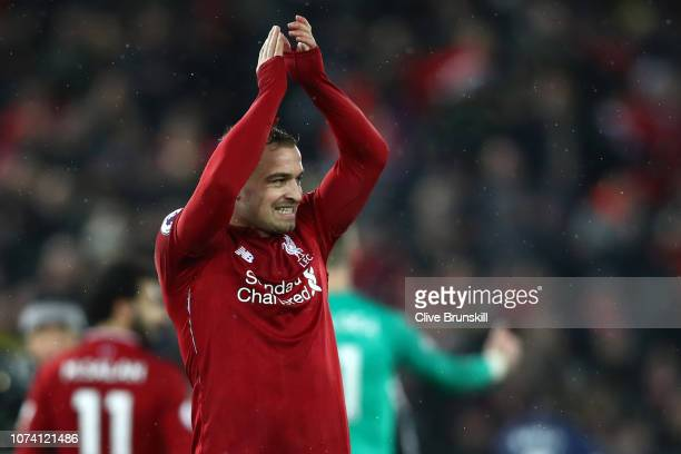 Xherdan Shaqiri of Liverpool celebrates following his sides victory in the Premier League match between Liverpool FC and Manchester United at Anfield...