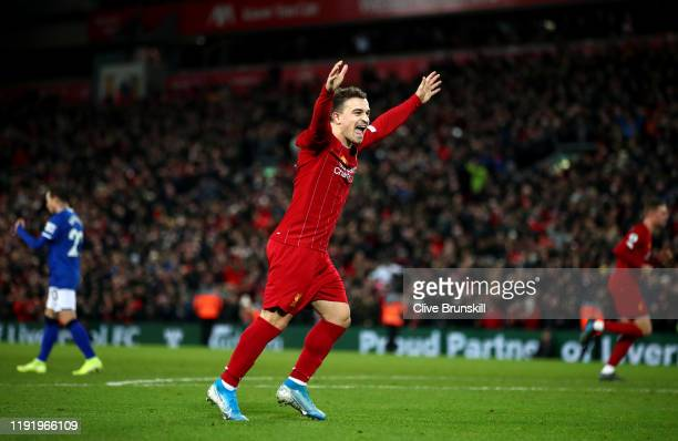 Xherdan Shaqiri of Liverpool celebrates his team's fifth goal during the Premier League match between Liverpool FC and Everton FC at Anfield on...