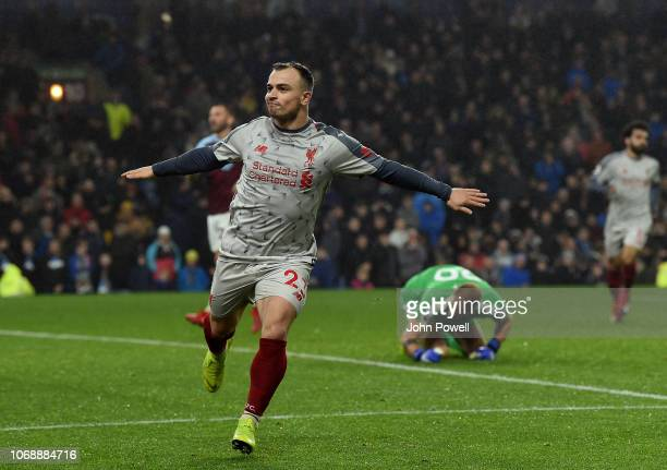 Xherdan Shaqiri of Liverpool Celebrates the winner and liverpools third during the Premier League match between Burnley FC and Liverpool FC at Turf...